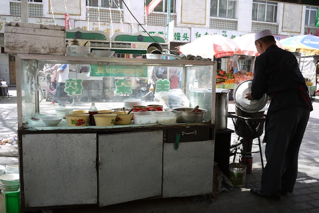 man preparing a soup in Yinchuan, China