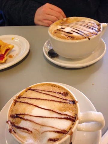 Two cappuccinos with pastry