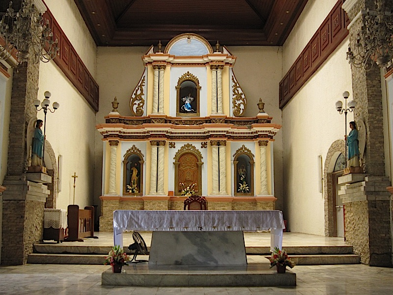 altar and retablo of St. Michael the Archangel Catholic Church in Bacnotan
