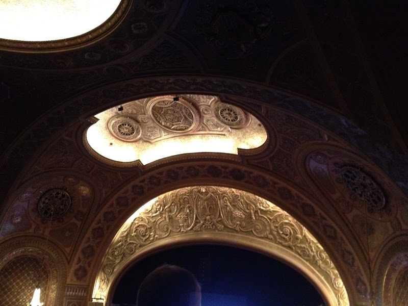 Above the stage in the Paramount Theater.