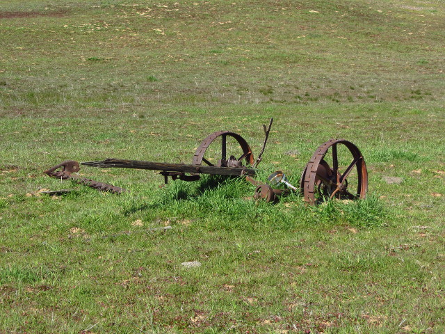 an old mower, probably drawn by horses