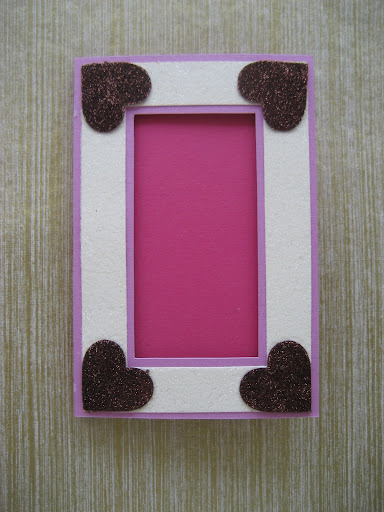 Emily glittered the hearts to create this frame card.