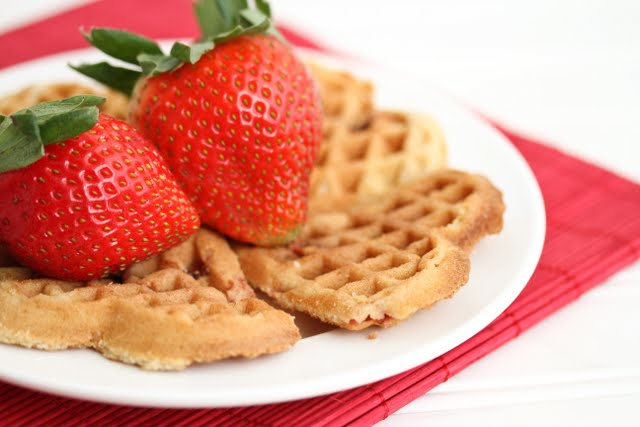 close-up photos of fresh strawberries on top of waffles