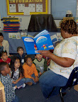 Teacher reads to a preschool class.
