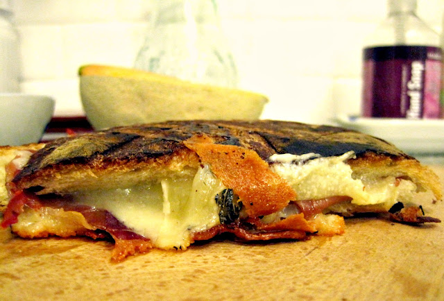 peering into the center of cheese and meat bliss; Pane in Cassetta <Grilled or Toasted Panino> with Prosciutto di Parma, Cheese, and Pane Pugliese
