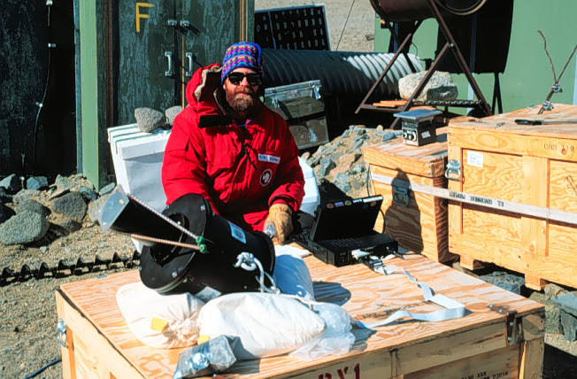 Ed Adams prepares to take ice measurements, 1994.