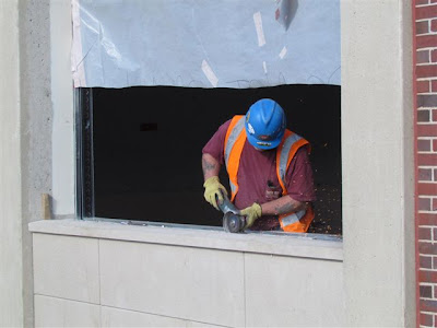 Precast panel installed beneath window opening