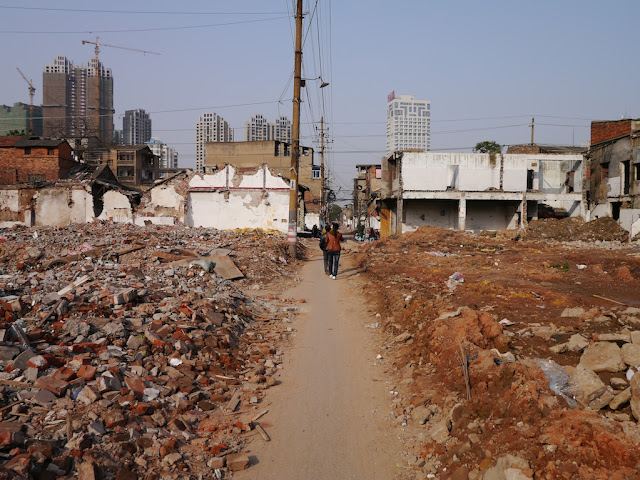 narrow pathway through rubble at Beizheng Street in Changsha