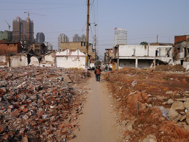 narrow pathway through rubble at Beizheng Street in Changsha