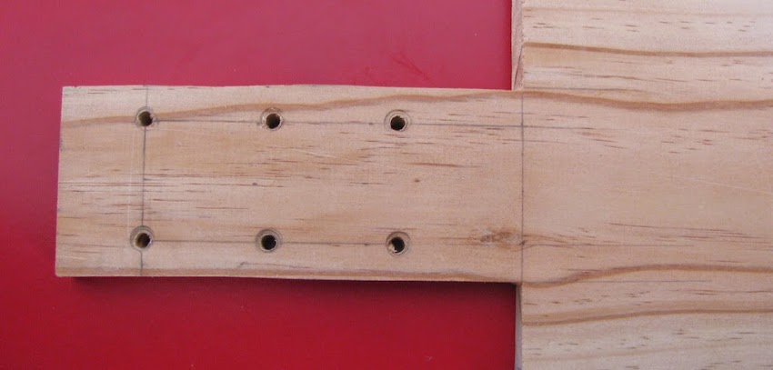 Headstock with drill holes