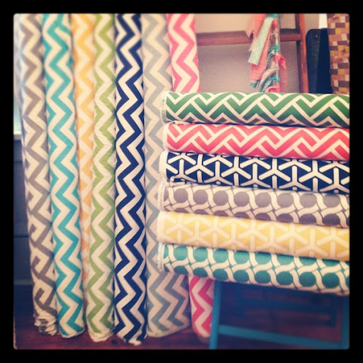 gorgeous multicolored chevron fabric bolts at drygoods design