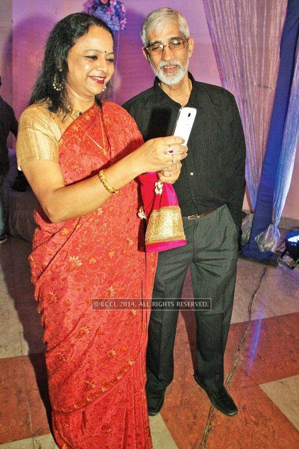 Jayashree and Rajat at Harsh and Khushboo's engagement ceremony coinciding with Vipul and Anuj Varshney's 25th wedding anniversary in Lucknow.