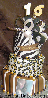 3 Tier mad hatter (topsy turvy) leopard and zebra print brown, black and gold girl's sweet sixteen unique birthday cake with edible bow and 16 topper