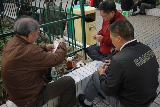 men playing a card game in Changsha, China