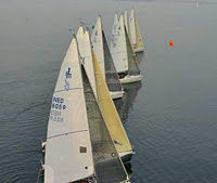 J/80 one-design sailboat fleet- sailing off starting line- Belgium & Netherlands Nationals