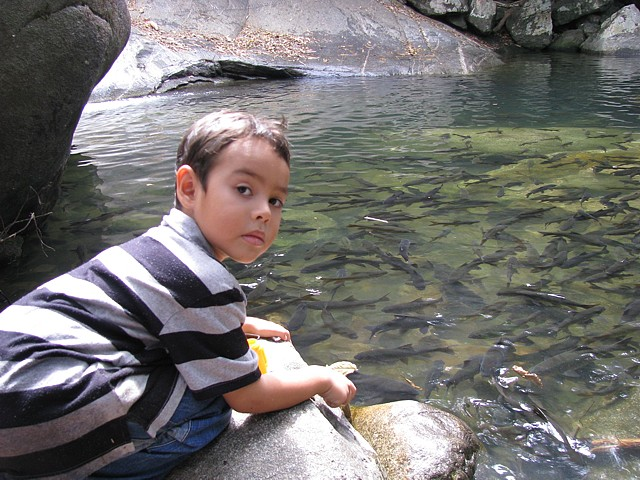 Children love to visit Khao Chamao and feed the fish in the river