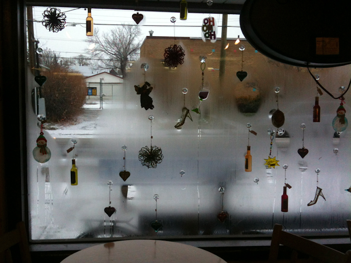 Silhouettes of heart-shaped Christmas ornaments in the window of Bell's Bookstore & Cafe, Calgary