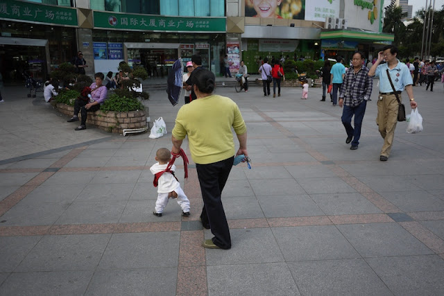 kid on leash with open pants in Zhuhai, Guangdong