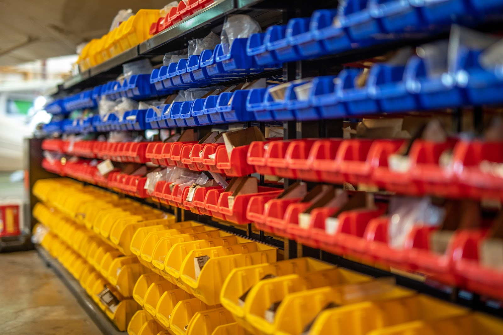 Color-coded rows of storage are arranged neatly on shelves.