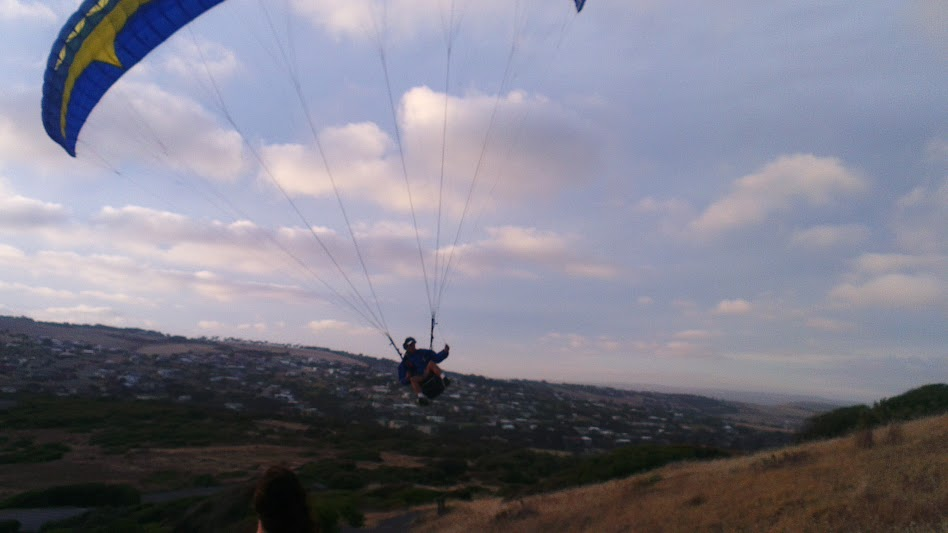 Random paraglider drops in on us – Ash Simmonds