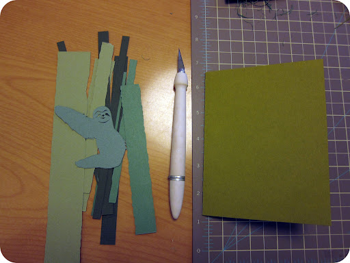 I decided to make the card monochromatic in all green. I cut a few strips of green paper to simulate tree trunks—of course making one the perfect width for the sloth to hang on to.