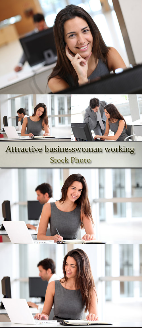 Stock Photo: Attractive businesswoman working on laptop computer