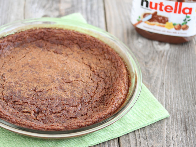 photo of a whole Nutella Magic Custard Cake in a pie dish