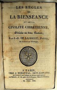 Portada con letra redonda y otra manuscrita que no es la del contenido del libro
