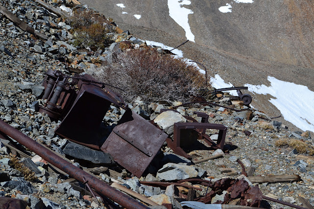 ruined ore carts down the mountain