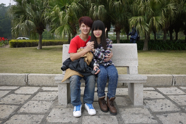 young couple siting on park bench in Zhuhai