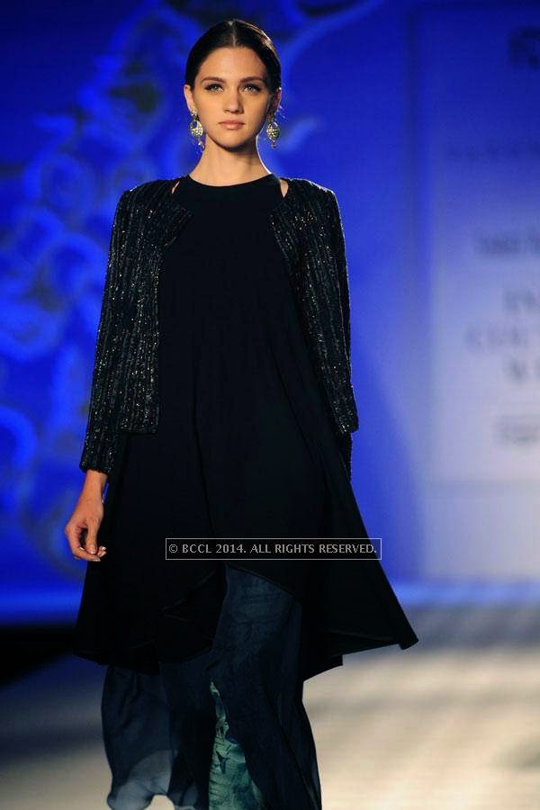 A model walks the ramp for Varun Bahl walks the ramp on Day 3 of India Couture Week, 2014, held at Taj Palace hotel, New Delhi.