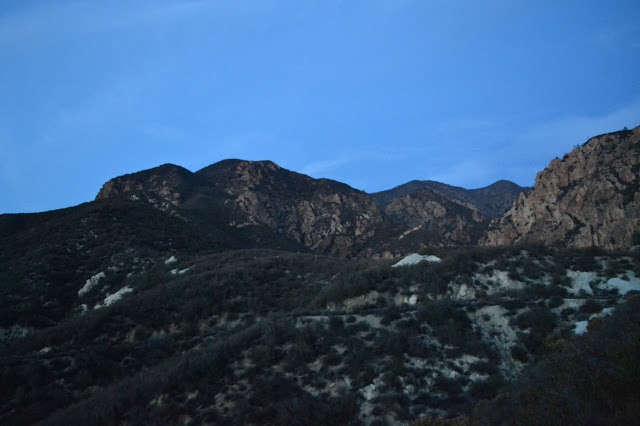 a blurry and steep mountain in the twilight