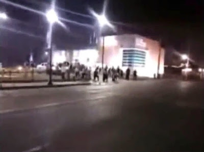 Two officers shot in Ferguson - video