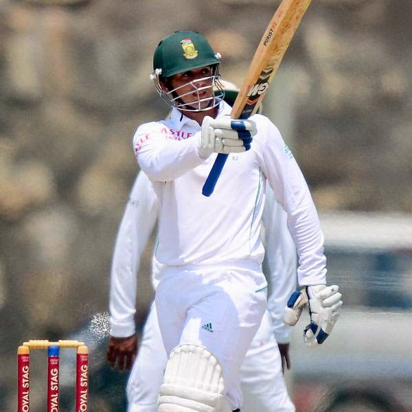 South Africa cricketer Quinton de Kock raises his bat to the crowd after scoring his half-century (50 runs) during the second day of the opening Test match between Sri Lanka and South Africa at the Galle International Cricket Stadium in Galle on July 17, 2014