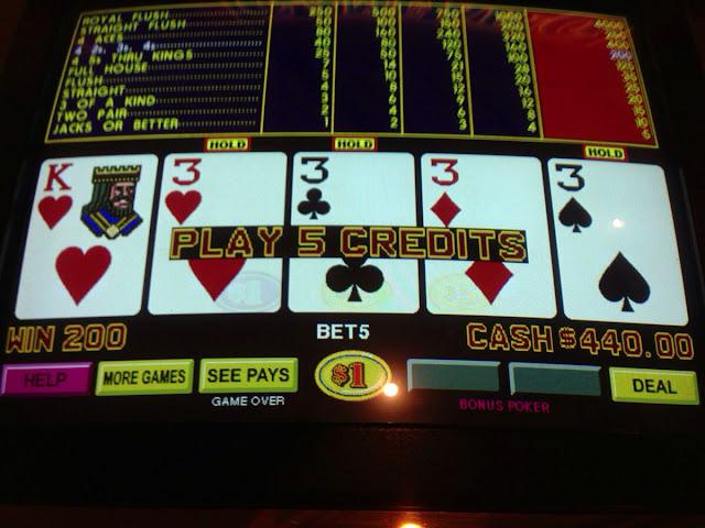 Dollar Video Poker Quad Threes