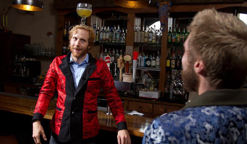 Red Dragon Jacket Tyler balances beer on head