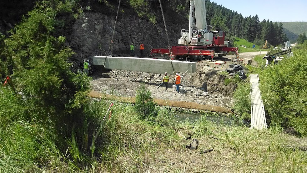 crane lowering bridge beam into place