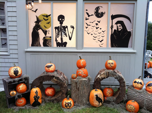 A splendid set-up with beautifully carved pumpkins and window clings.