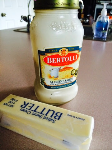 Bertolli Alfredo Sauce and a stick of butter.