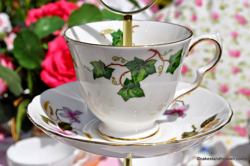 ivy leaf vintage teacup and saucer on a cake stand