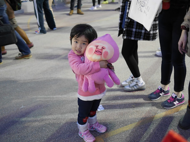 little girl hugging a stuffed toy