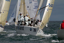 J/24 one-design sailboat- sailing in rough sailing conditions sailing off Australia