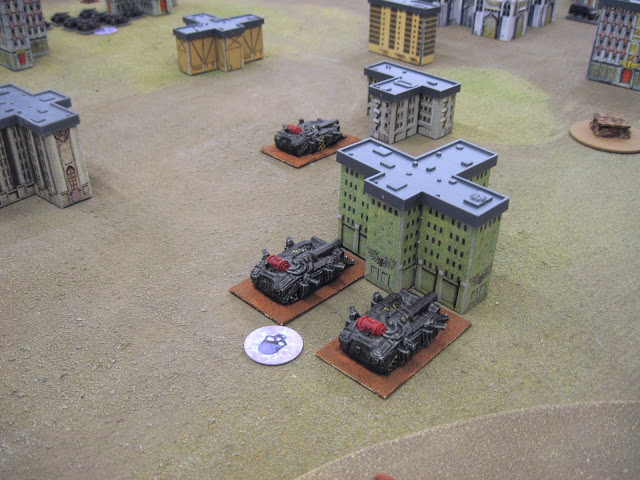 The Decimators ram some buildings.