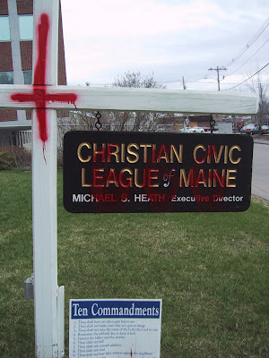 League sign defaced by vandals
