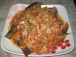 sarciadong isda is a fried fish with a sauce baste on tomato, it is very popular for day to day dishes