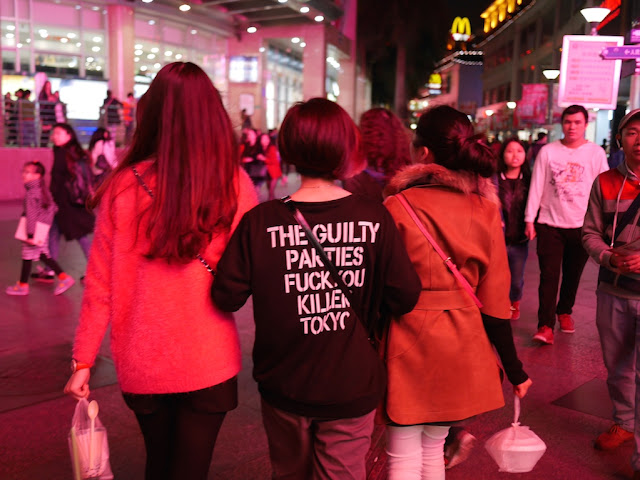"back of shirt with words ""THE GUILTY PARTIES  — FUCK YOU KILLER TOKYO"""