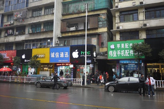 several stores in Chenzhou with Apple logos on their signs