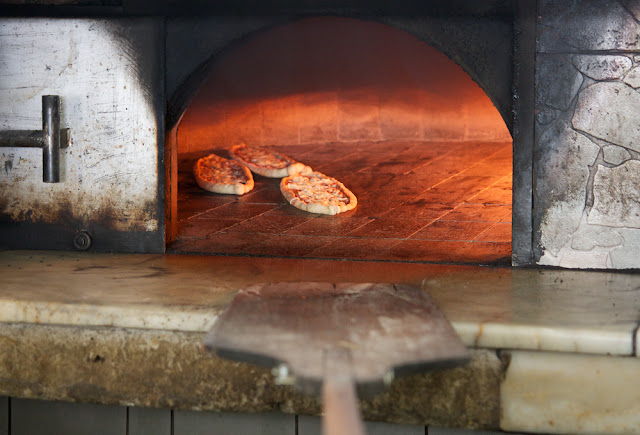 in the wood-fired oven
