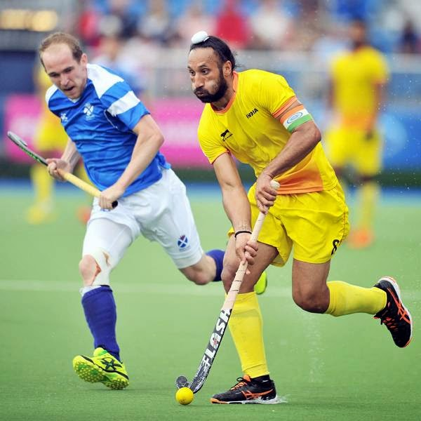 Sardar Singh of India (R) vies with Gordon McIntyre of Scotland during a men's field hockey match between India and Scotland at the Glasgow National Hockey Centre at the 2014 Commonwealth Games, in Glasgow, on July 26, 2014.