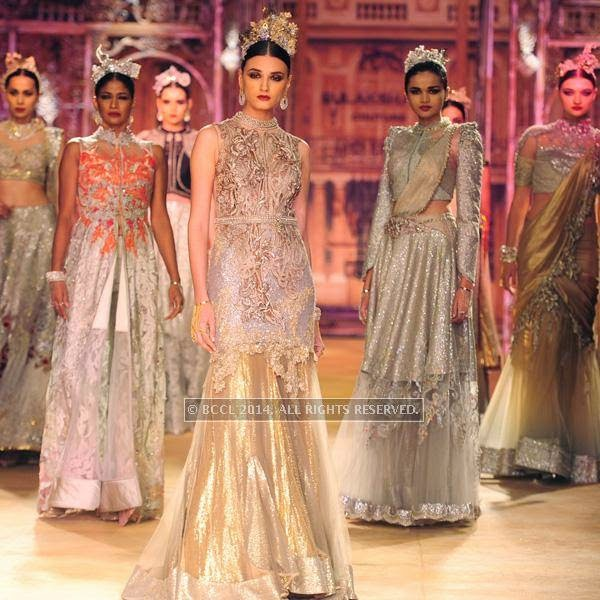 Models walk the ramp for Sulakshana on Day 6 of India Couture Week, 2014, held at Taj Palace hotel, New Delhi.<br />